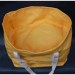 Take ShelfBag on a picnic. Wine and a blanket go under the shelf. Cheese, bread and apples on top. The handles are long enough for shoulder carry.