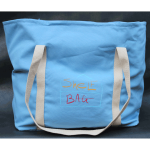 Ice blue ShelfBag is really cool. It's 14 inches tall, 14 inches wide, and 8 inches deep. That's 1,568 cubic inches. And, it fits on your shoulder.